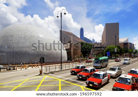 HongKong traffic day, red taxi and landmark buildings - stock photo