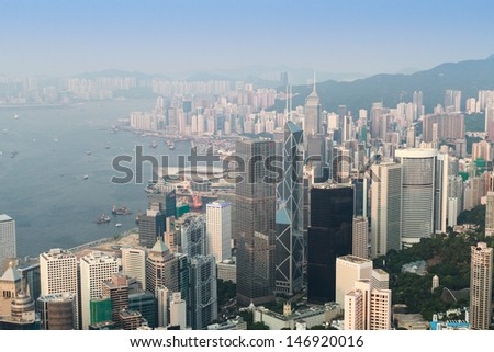 HONK KONG � JULY 14: Daytime view of Victoria Harbour on July 14, 2013. The Victoria Harbour is world-famous for its stunning panoramic night view and skyline. - stock photo
