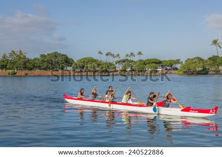 Honolulu, Dec. 29:   Close-up of an outrigger canoe team training for the Hawaii State Canoe Championships.  Honolulu, Hawaii, USA.  Dec. 29, 2014. - stock photo