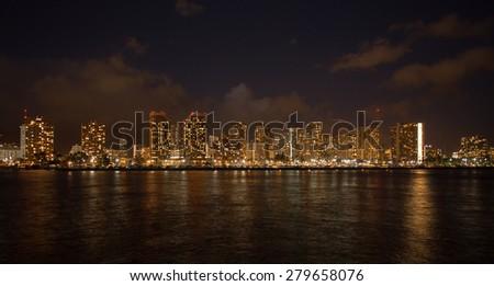 Honolulu downtown at night, Oahu Hawaii - stock photo