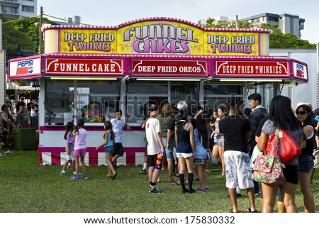 HONOLULU - FEBRUARY 8: A food stand serves carnival desserts on February 8th at the 2014 Punahou Carnival in Honolulu, Hawaii.  Proceeds from the Carnival benefit the schools financial aid program. - stock photo