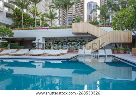 Honolulu, Hawaii, USA, April 11, 2015:  Morning light reflects off the lower deck pool at The Modern Hotel.  The Modern is Honolulu's most exclusive getaway spot for the rich and famous. - stock photo