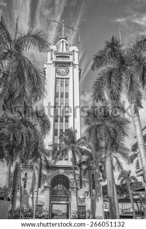 Honolulu, Hawaii, USA, April 3, 2015:  The historic Aloha Tower, formerly the tallest building in Hawaii, is now undergoing a complete refurbishment. Aloha Tower is the gateway to Honolulu Harbor. - stock photo