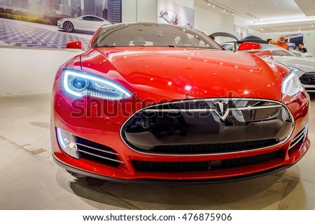 Honolulu, Hawaii, USA - Dec 21, 2015: Red Tesla Model S70 electric vehicle on display in a showroom at Ala Moana Center. Front view.