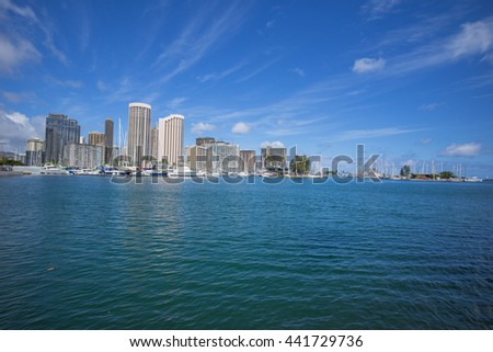 Honolulu, Hawaii, USA, June 23, 2016:  Ocean view of the Ala Wai Small Boat Harbor with Waikiki resorts and hotels in the background.