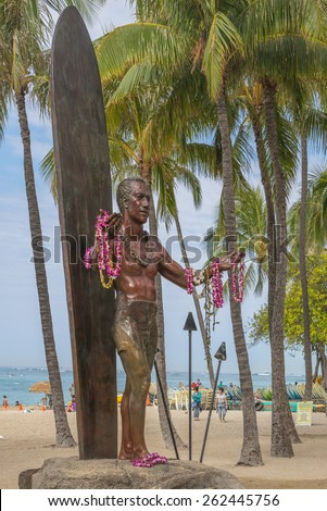 Honolulu, Hawaii, USA, March 21, 2015: The historic  Duke Kahanamoku Statue pays homage to the Father of Hawaiian Surfing and stands in Waikiki at Queen's Beach. - stock photo