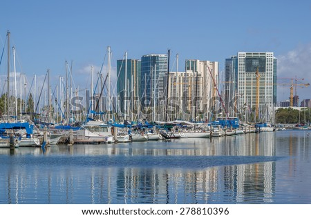 Honolulu, Hawaii, USA, May 18, 2015:  Honolulu morning view of the restored Ala Wai Small Boat Harbor as the State of Hawaii prepares to welcome  the visiting boaters. - stock photo