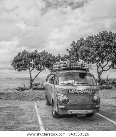 Honolulu, Hawaii, USA, Nov. 24, 2015:  Morning view of an antique surfer van with roof rack and surfboards.  Waikiki surfing favors older vehicles for transportation. - stock photo