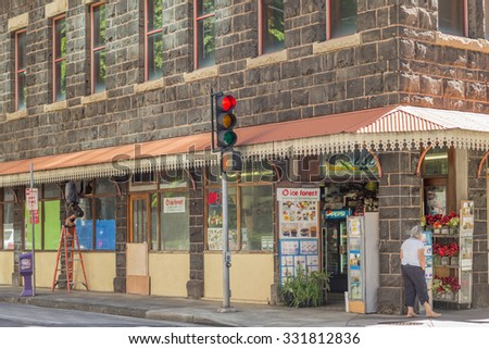 Honolulu, Hawaii, USA, Oct. 26, 2015:  Morning view of daily life on Merchant Street as modern businesses occupy a two century old lava block building.  Merchant Street is a popular tourist stop. - stock photo