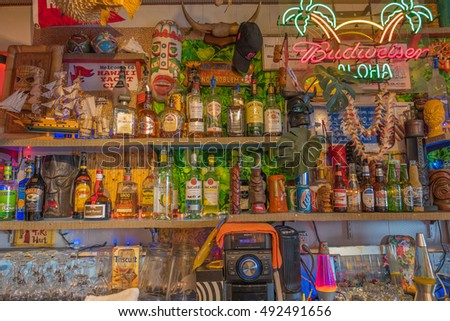 Honolulu, Hawaii, USA, October, 3, 2016:  Closeup view of the new Tiki Bar at the Hawaii Yacht Club with colorful memorabilia in the backdrop.
