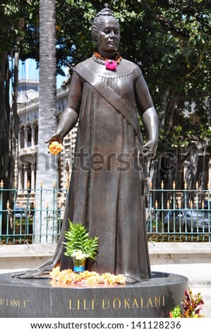 HONOLULU, HI - MAY 29: Queen Lili'uokalani Statue outside of the Hawaii State Capitol Building  in Honolulu, Hawaii on May 29, 2010, Queen Liliuokalani was the last monarch of the Hawaiian islands. - stock photo