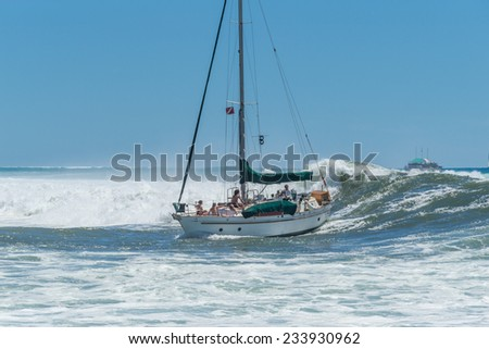 Honolulu, Sept. 14, 2014:  A 35 foot sailboat is caught by a large wave while entering the Ala Wai Harbor.  Honolulu, Hawaii, USA  Sept. 14, 2014.
