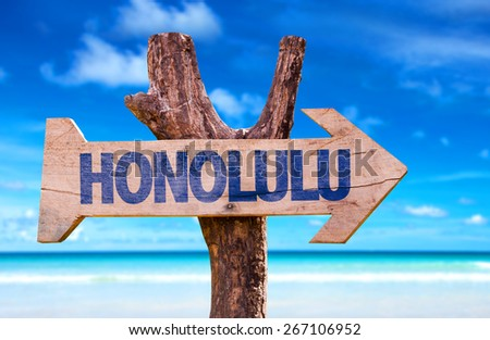 Honolulu sign with a beach background - stock photo