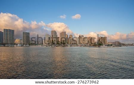 Honolulu skyline with seafront at sunset, Hawaii - stock photo