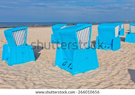 Hooded beach chairs (strandkorb) at the Baltic seacoast in Swinoujscie city, Poland - stock photo
