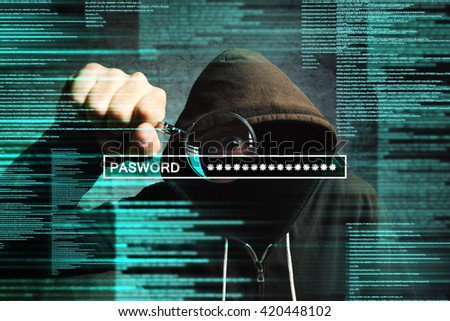 Hooded computer hacker with magnifying glass stealing internet password, online security concept. - stock photo