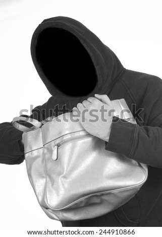 Hooded thief steals personal information - stock photo