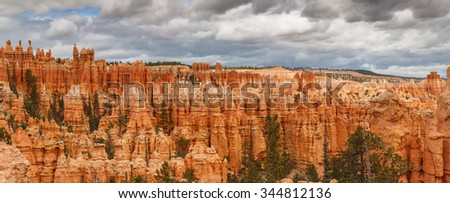 Hoodoos of Bryce Canyon under a cloudy sky, Utah, USA.