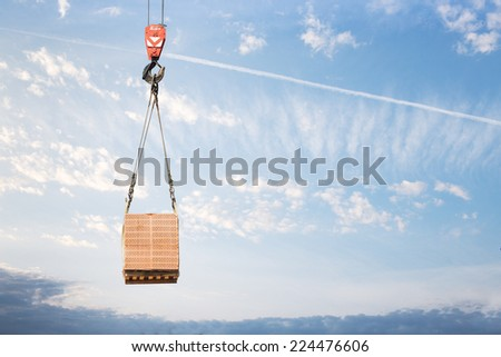 Hook cargo crane on the sky background - stock photo