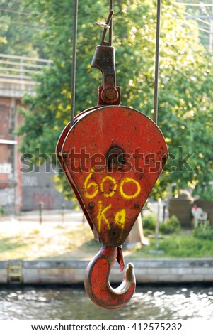 hook of crane with load limit sprayed on - stock photo