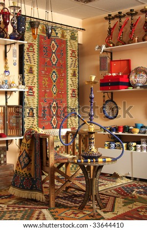 Hookah on a little table in shop of east culture
