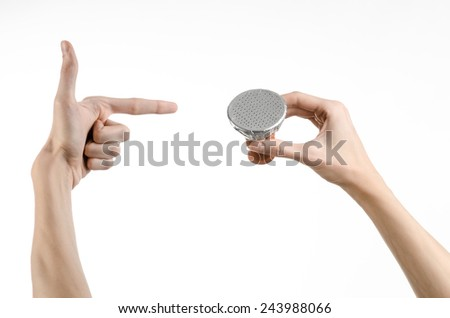 Hookah topic: Bartender holding a clay bowl with tobacco for hookah covered with a foil with holes isolated on a white background - stock photo