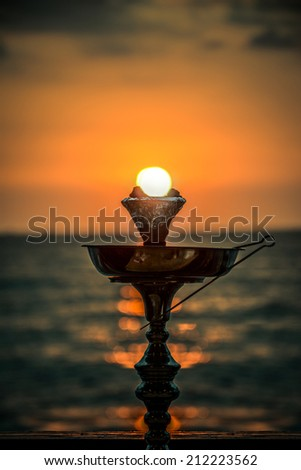 Hookah with sunset behind  - stock photo