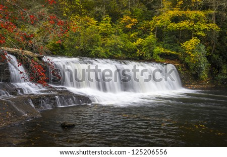 Hooker Falls Autumn Waterfalls Dupont State Forest NC Fall Foliage nature and landscape photography - stock photo