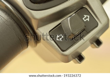 hooter button on motorcycle - stock photo