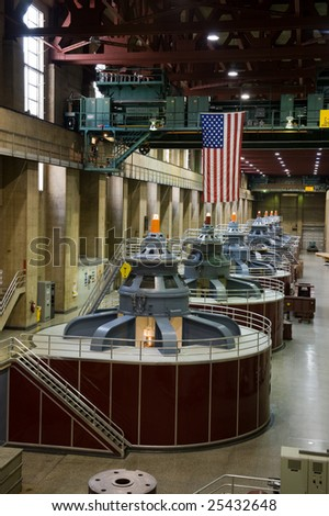 Hoover dam generators with American flag in background - stock photo