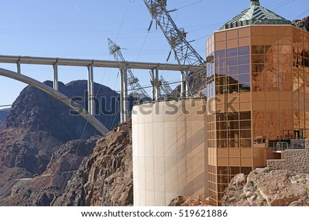 Hoover Dam Nevada buildings and power line support structures, with the Mike O'Callaghan-Pat Tillman Memorial Bridge in the background