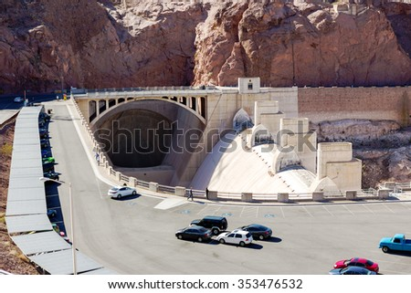 Hoover Dam view at parking and entrance to the massive spillway tunnel at Hoover dam - stock photo