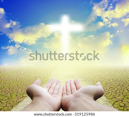 hope.Christianity:Believe in God,Crucifix in Hand with nature abstract background - stock photo