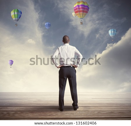 Hopeful businessman searching for the future - stock photo