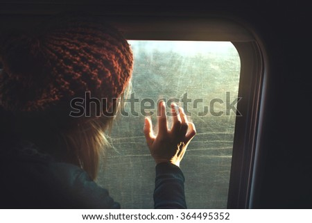 hopeful woman looking out from the wagon window - stock photo