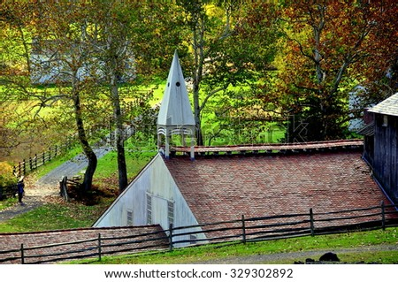 Hopewell Furnace, Pennsylvania - October 15, 2015:  The Cast House with its distinctive wooden roof cupola at Hopewell Furnace National Historic Site - stock photo