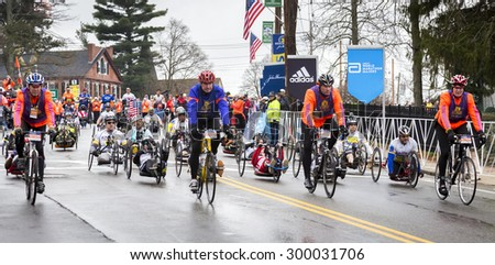 Hopkinton, MA, USA - April 20, 2015: The Boston Marathon 2015 with athletes with disabilities competing a few minutes after the start of the race in Hopkinton, MA, USA on April 20, 2015. - stock photo