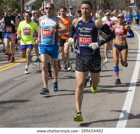 HOPKINTON, USA - APRIL 21: Amateur athletes heading fast and steadily from Hopkinton to Boston in Massachusetts, USA a few minutes after the start of the Boston Marathon 2014 on April 21, 2014.