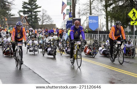 Hopkinton, USA - April 20: Athletes with disabilities competing in the Boston Marathon 2015 a few seconds after the start of the race in Hopkinton, Massachusetts, USA on April 20, 2015. - stock photo