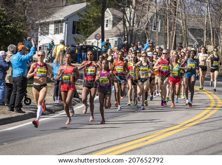 HOPKINTON, USA - APRIL 21: Elite female athletes heading fast and steadily from Hopkinton to Boston in Massachusetts, USA a few minutes after the start of the Boston Marathon 2014 on April 21, 2014.