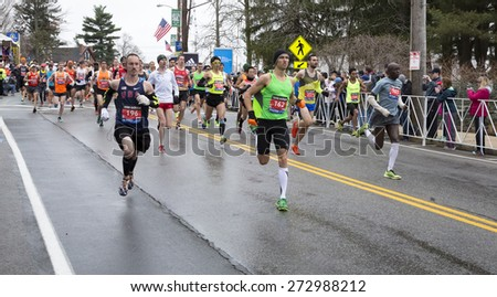 HOPKINTON, USA - APRIL 20: Runners heading to Boston downtown during the Boston Marathon 2015 a few minutes after the start of the competition in Hopkinton, Massachusetts, USA. - stock photo