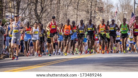 HOPKINTON, USA - APRIL 15: Runners of the Boston Marathon 2012 heading from Hopkinton to Boston downtown fast and steadily right after the start on April 15, 2012 in Hopkinton, Massachusetts, USA. - stock photo
