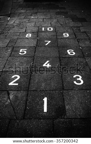 hopscotch game on a sidewalk - stock photo