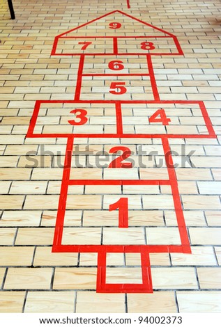 Hopscotch game painted on the school pavement. - stock photo