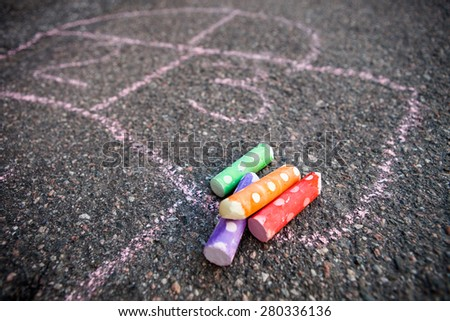 Hopscotch on the ground with colorful street chalk - stock photo