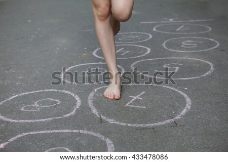 hopscotch, Young girl playing hopscotch