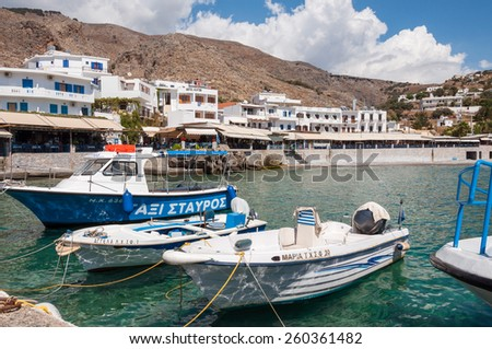 HORA SFAKION, GREECE - SEPTEMBER 15. Fishing boats in front of the promenade at the seaside of the village Hora Sfakion on Crete on September 15, 2014.  - stock photo