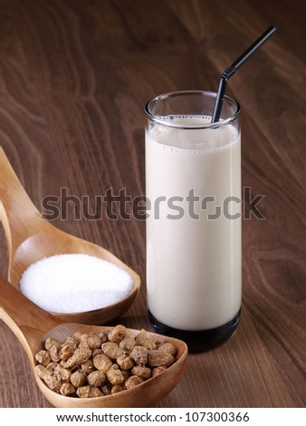 Horchata. Horchata is a drink, made with the juice of tiger nuts and sugar.  Native from Valencia � Spain, it is a refreshing drink, often accompanied with long thin buns called �fartons�. - stock photo
