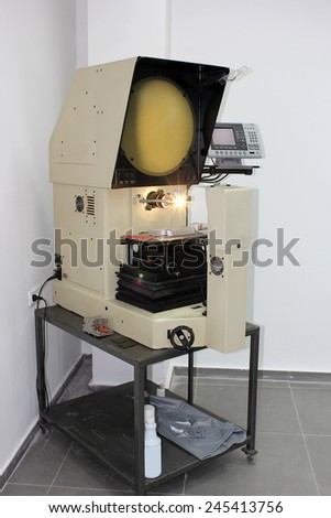 horizontal benchtop optical comparator -  modern electronic device for measuring - stock photo