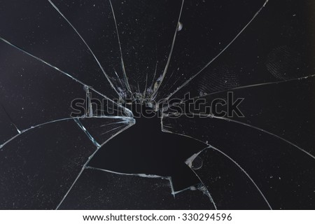 horizontal broken glass dark background - stock photo